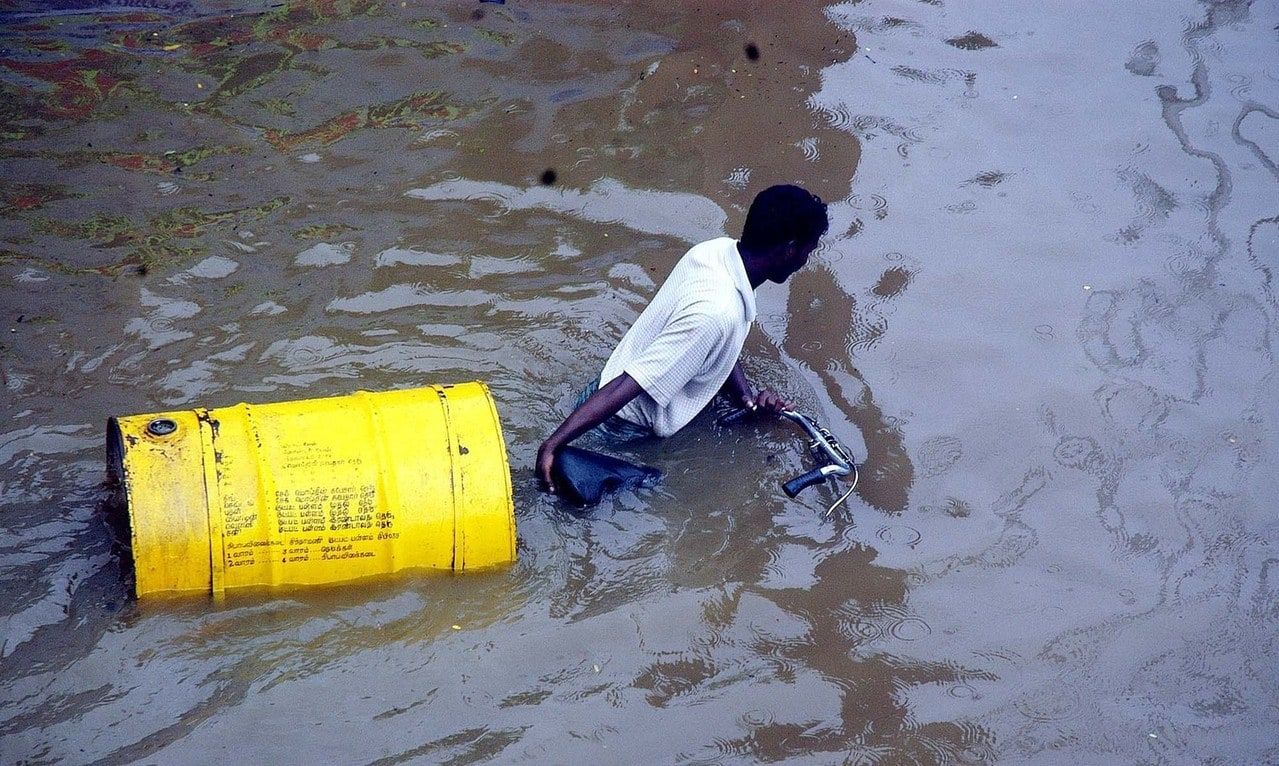 A sales man pulling his tricycle with kerosene tank in flooded water in the outskirts of Madras, India, Tuesday 25th October, 2005.   Heavy rainfall due to Northeast monsoon and a depression in the ocean of Bay of Bengal flooded almost all southern Indian States and for the first time for the last 40 years Mettur reservoir near Salem in Tamil Nadu received two lakh cusecs and discharged the same quantum flooded around 11 districts in Tamil Nadu.  (AP Photo M. Lakshman)